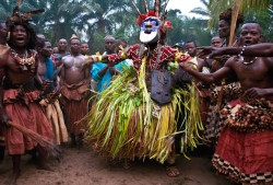 Kuba Masked Dancer Emerging from the Sacred Forest, D.R. Congo