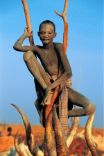Dinka Boy Perched on a Branch, South Sudan