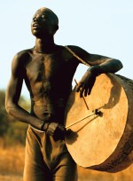 Dinka Man Playing Drum, South Sudan