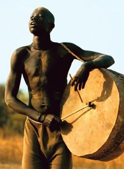 Dinka Man Playing Drum, South Sudan