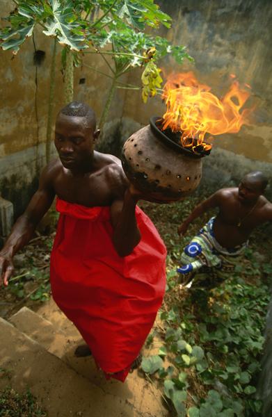 Voodoo Priest with Sacred Fire, Benin, Nigeria | Carol Beckwith