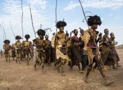 Dassenech Men Parade for the Dimi Ceremony, Ethiopia