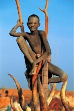Dinka Boy Perched on a Branch, South Sudan